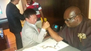 See What Abia State Governor Was Seen Doing With A Chinese Investor. Photos